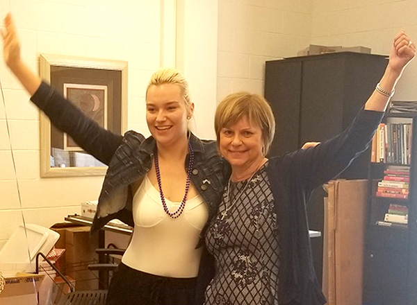 HFC alumna Allison Jones (left) and HFC Interior Design program coordinator Karen Wilmering (right) pump their arms in victory after learning Jones won 2nd place in the NKBA Student Design Competition.
