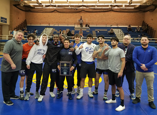 The HFC wrestling team celebrates their victory on Jan. 25 as they became the MCCAA State Champions.