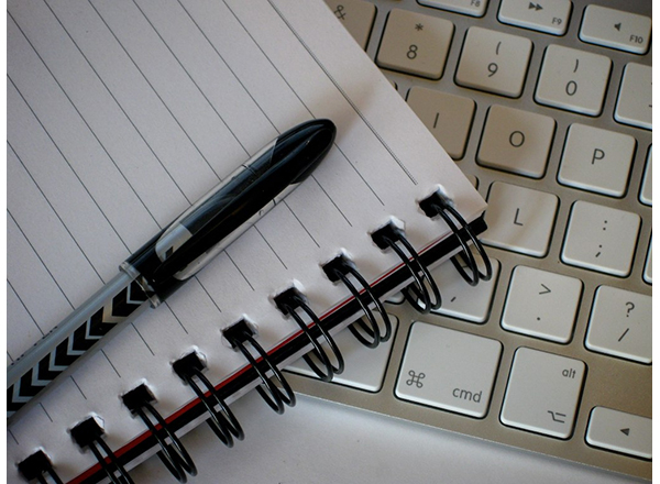 Graphic of a pen, notebook, and keyboard