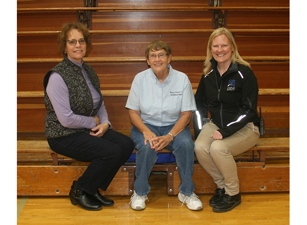 From left to right: Mary Jo Perkovich, Nancy Bryden, and Karen Schoen have a seat on the old bleachers before they're replaced.