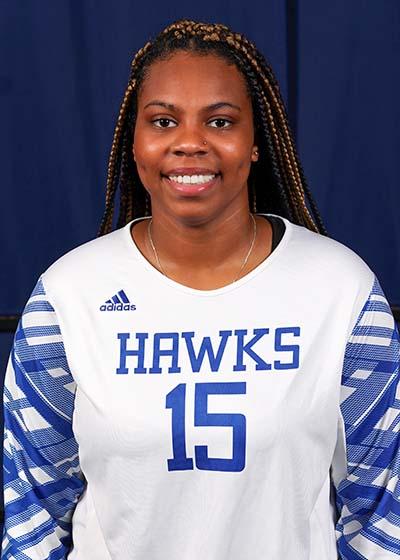 Portrait of Cierra Hampton on blue background