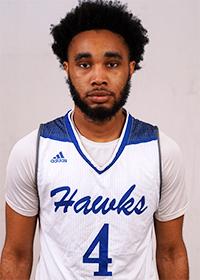 Portrait of Daniel Autrey Jr. wearing white Hawks jersey