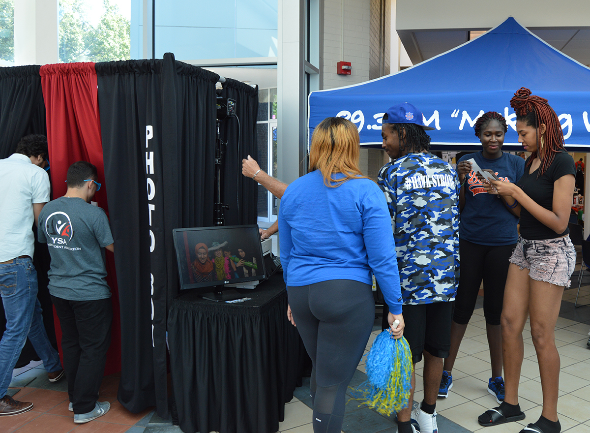 Students lining up at a photobooth to get their picture taken at an HFC campus event
