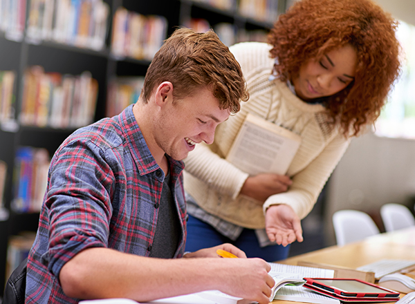 Students studying in library together at a table