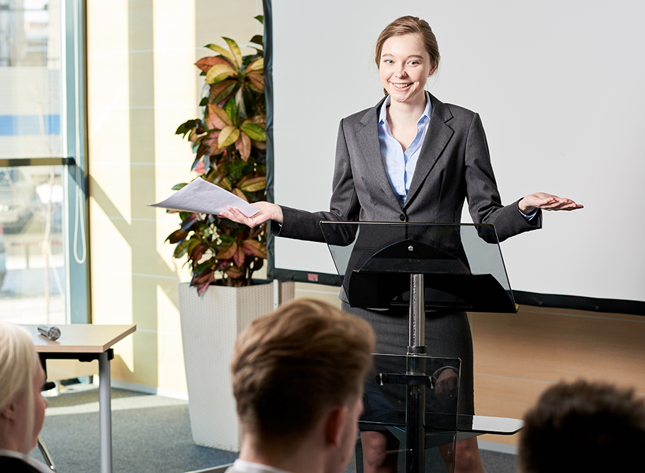 Student in business attire enthusiastically giving speech