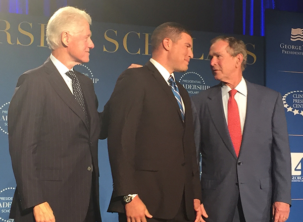 Russell Kavalhuna (center) with former Presidents Bill Clinton (left) and George W. Bush (right).