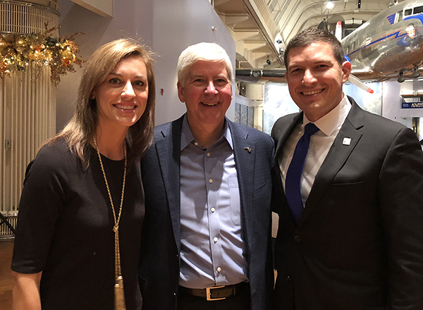 Russell Kavalhuna (right) with Courtney Kavalhuna and former Michigan Governor Rick Snyder.