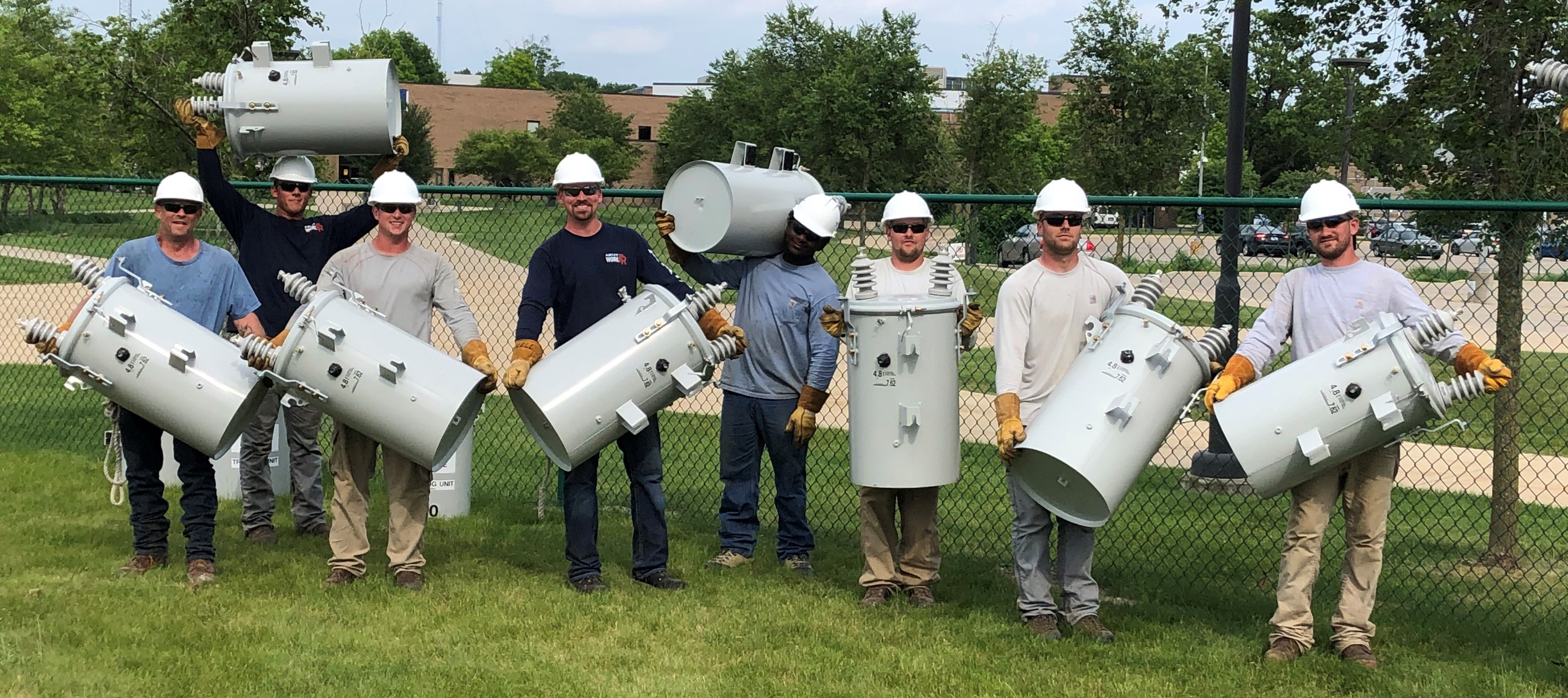 DTE workers show their muscle by lifting transformers. HFC is using oil-free transformers due to EPA regulations and the close proximity of the Rouge River.