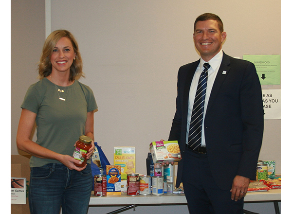 President Russell Kavalhuna and his wife Courtney contributed food items and toiletries to the recent food drive.