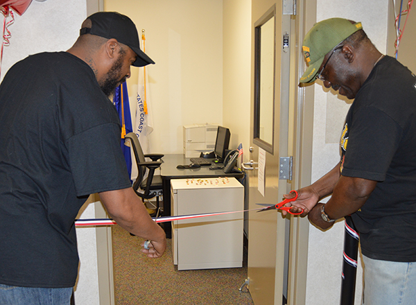 HFC student veterans Mark Allen and Ed Stokes did the honors of cutting the ribbon for the event.