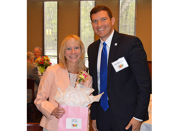 HFC President Russell Kavalhuna gives retiree Jan Artushin her gift.