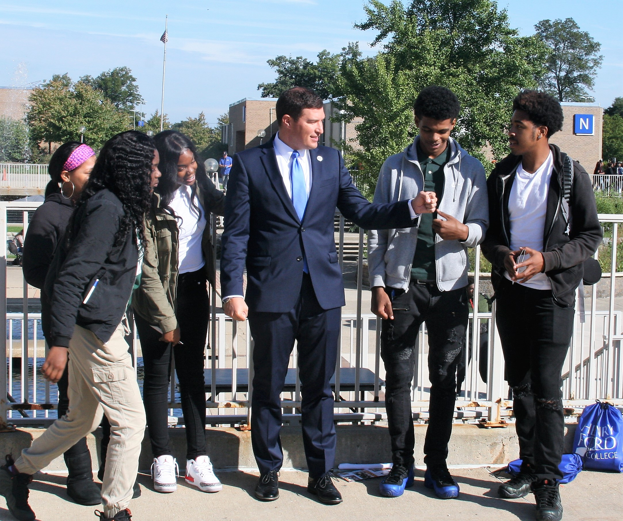 Students from Cody High School in Detroit hang around with President Russell Kavalhuna at Discover Day.