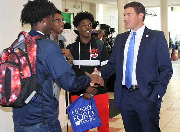 President Russell Kavalhuna chats with students during Discover Day.