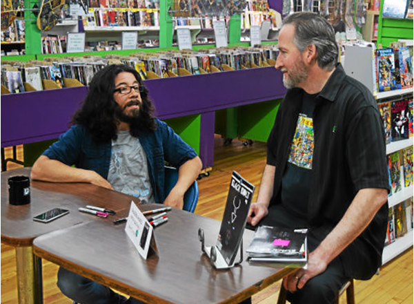 HFC alumni (from left to right): Award-winning writer Saladin Ahmed and Dan Merritt, co-owner of Green Brain Comics in Dearborn, at one of Ahmed's previous signings.