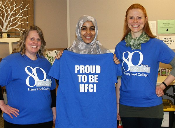 Three women modeling 80th anniversary HFC T-shirts