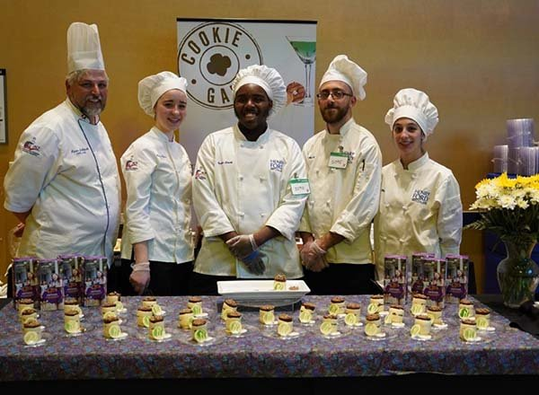 Group photo of Chef Jablonski and students in chef attire