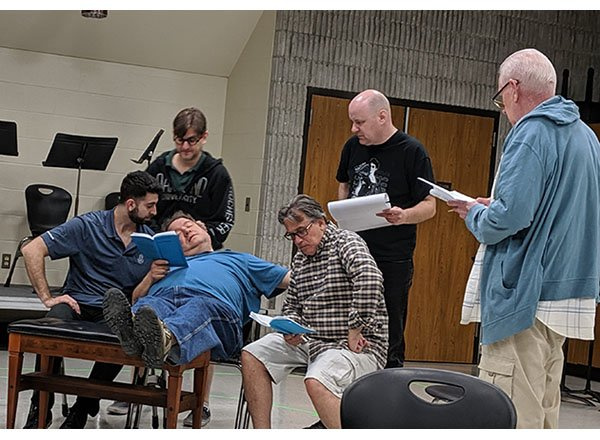 Action shot of 6 actors rehearsing