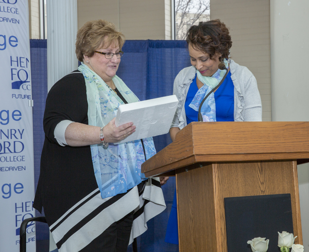 Administrator award winner Debbie Szymanski receives her award from Rhonda Johnson
