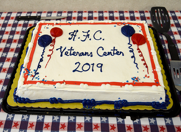 The celebrative cake was decorated in patriotic colors.