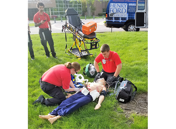 HFC students perform a simulated 911 call with a high-tech patient simulator on campus grounds