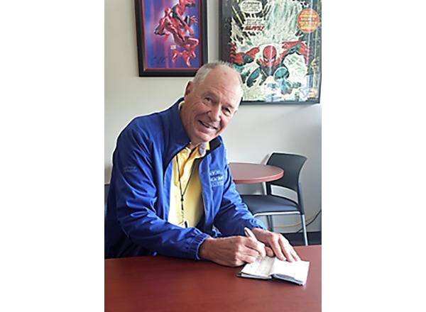 Photo of John Carroll at desk