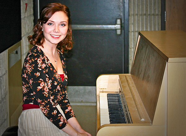 Taylor Charbonneau at the piano