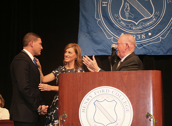 President Kavalhuna, his wife Courtney, and Board of Trustees Chair Michael Meade