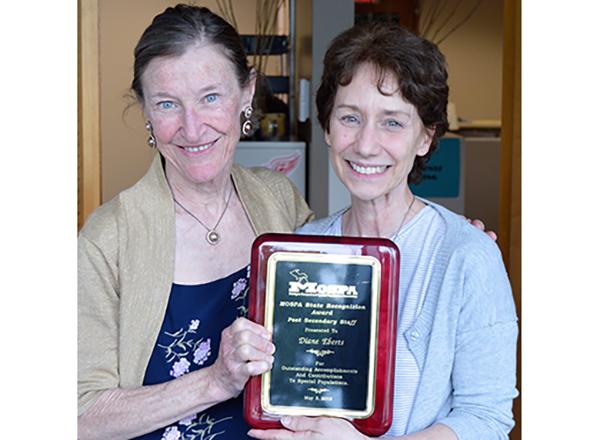 Maureen Webster (left) congratulates Diane Ebert on her award