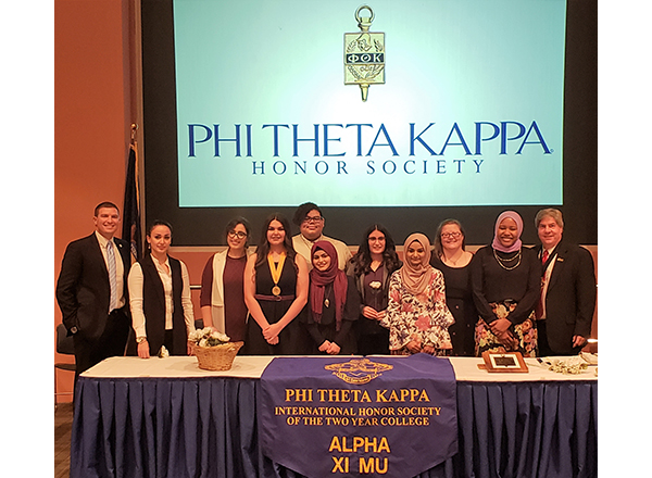 Group photo of the Nov. 16 ceremony featuring Kavalhuna, Nealon, and students