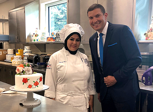 President Kavalhuna meets with a culinary student