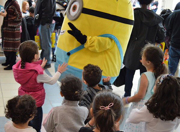 Children play with a life-sized Minion