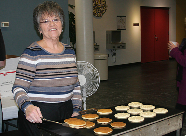 Woman serving pancakes