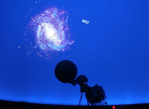 Image of night sky with silhouette of screen equipment