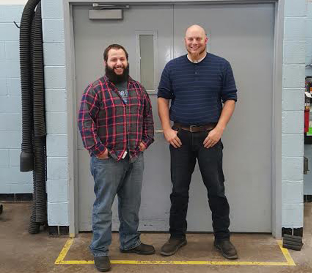 Robert Morantes (left) stands with ASSET Lead Instructor Kristopher Young.