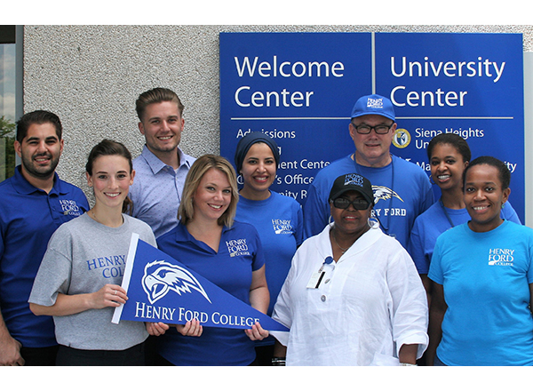 A group of HFC Enrollment Services employees smiling, showing off their HFC spirit