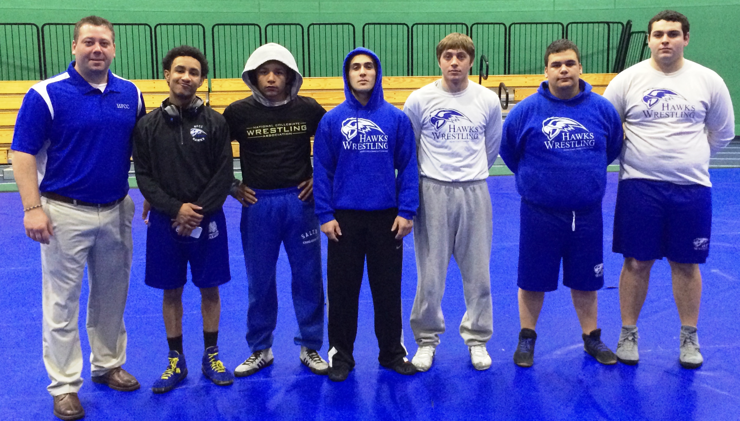 The HFCC Wrestling Club, left to right: Coach MacKenzie, Trey Berry of Plymouth (125 lb. class), Jesse O'Neal of Westland (133 lb. weight class), Ali Saad of Dearborn (141 lb. weight class), Jeremy Stankewitz of Plymouth (157 lb. weight class), Hass Doueik of Dearborn Heights (285 lb. weight class), and Dave Velez of Southgate (285 lb. weight class).