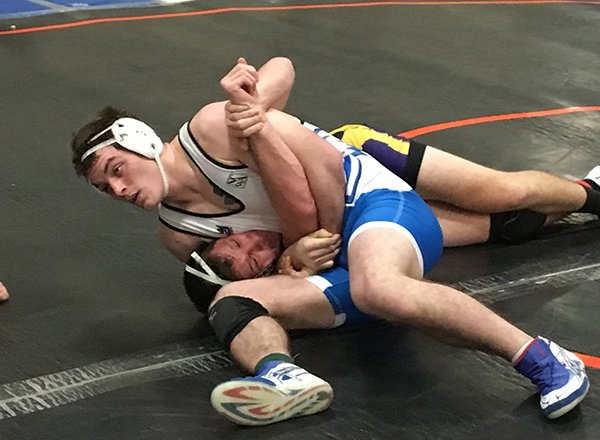 HFC Wrestler John Haggerty puts the squeeze on his opponent!